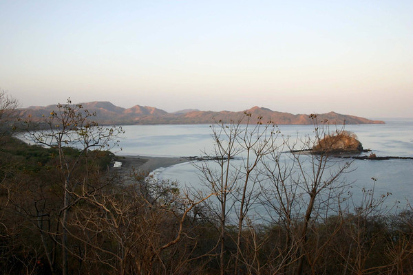 Day's first light from atop Punta Salinas - down to Playa Flamingo (and island) - across Bahia Brasilito - to Punta Sabana - in the dry Pacific coastal area of the Guanacaste province