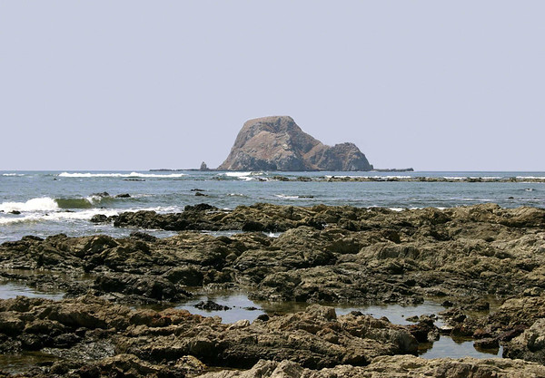 Across the tide pools at Cabo Blanco (White Cape) - the southernmost tip of the Nicoya Peninsula - out to the bird sanctuary island of Isla Cabo Blanco - Cabo Blanco Nature Reserve - Puntarenas province