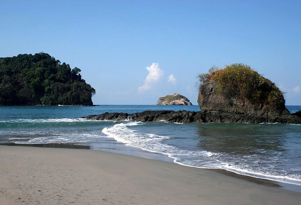 From Playa Espadilla Sur - to the northwestern tip of Punta Catedral - and out to Isla Olocuita, below the cumulonimbus cloud - Manuel Antonio National Park - Puntarenas province