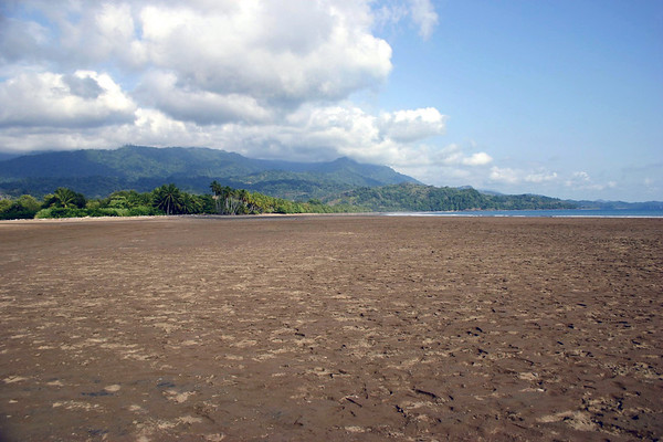 Playa Uvita - viewing southeast across the Marine Whale National Park, with Playa Ballena in the distance, also part of the park - with the foothills of the Cordillera de Talamancan, under the cumulus clouds behind - Puntarenas province