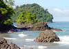 From the shoreline at Punta Catedral - beyond a rock island outcrop and across the mouth of the inlet to Playa Manuel Antonio - Manel Antonio National Park - Puntarenas province