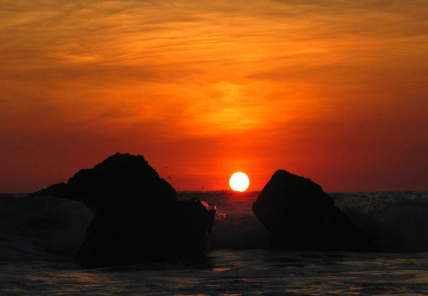 Sunset upon the Pacific Ocean wave breaking against the coastal rock outcrops, at Playa Tortuga (Turtle Beach) - Puntarenas province