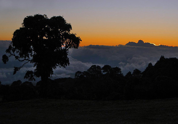 Sunset from the slopes of the Irazu Volcano slopes - that are parallel with the cumulus cloud tops - Irazu Volcano National Park - Cartago province