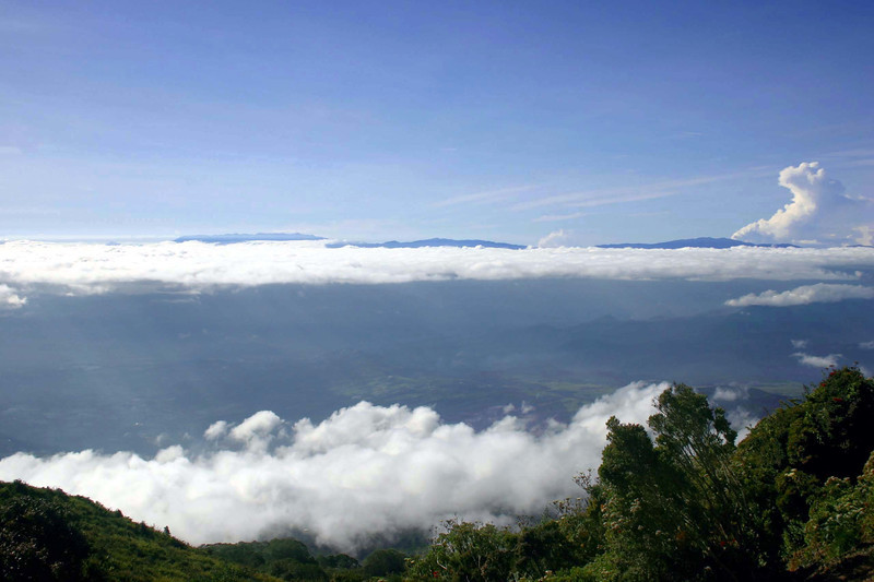 Atop the Turrialba Volcano, rising to 10,919 ft. (3,328 m), in the Turrialbo Volcano National Park, in the Cordillera de Central (mountains) - viewing southward above the stratus clouds, to the distal Cordillera de Talamanca (mountains) - Cartago province