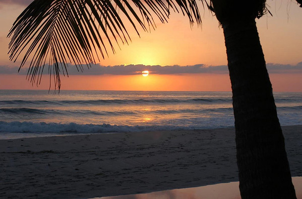 Playa Malpais sunset - with a stratus cloud, paralleling the southern coastal end of the Nicoya Peninsula - northern end of the Puntarenas province