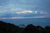 Sunset over the rain forest of Manuel Antonio National Park - with the southern end of the Nicoya Peninsula, about 70 mi. (113 km) northwestward along the distal horizon (R) - Puntarenas province