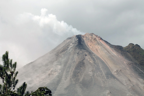 Volcán Arenal - emitting sulfuric gases, steam vapor, and suspended ash from its vent - Arenal Volcano National Park - Alajuela province