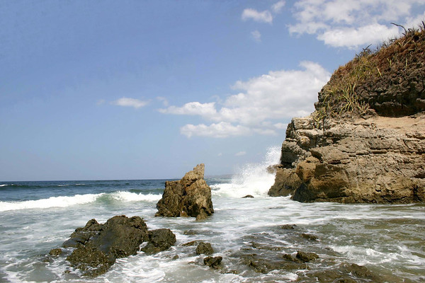 From the rocky inlet beach, with Pacific waves crashing into the Punta Roca headland, at the southern end of Playa Nosara - Nicoya Peninsula - Guanacaste province