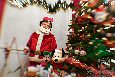 Christmas tree with Christmas lights and Santa Claus. ….. taken with the Lensbaby Composer Pro with the double glass optic and creative aperture kit.  © Copyright Hannah Pastrana Prieto