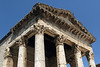 Temple of Augustus (Augustov Hram - Croatian) - with its portico supported by 6 columns with ornate Corinthian capitals - afternoon sunlight in Pula city.