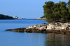 Point Skaraba, during mid flood tide - beyond the stone pines to Maskin Island - with Sturag Island (forrested) and Sveti Ivan na Pucini (St. John Lighthouse) beyond - Istria region and county.