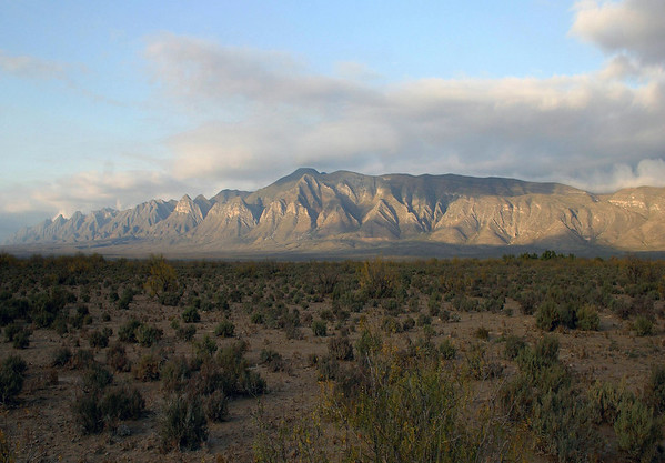 Across the shaded Chihuahuan Desert (largest in North America at 200,000 sq. mi.) - to the day's last sunlight along the 20 mi. long Sierra Hermanas (part of the Sierra Madre Oriental) then fusing with the Sierra Abayos for another 20 miles - Coahuila state.