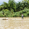 Woman pushing a raft on the Tao river near Baracoa