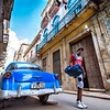 Old Havana, CUBA - March 19, 2016.  Old blue car and pedestrian walking on street in Old Havana.