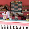 Friendly lady at food stand on road side