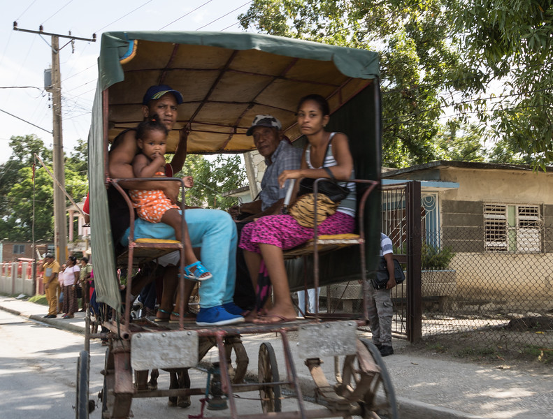 Family traveling by horse carriage