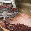 Roasted cocoa beans are ground to form chocolate paste at a farm near Baracoa