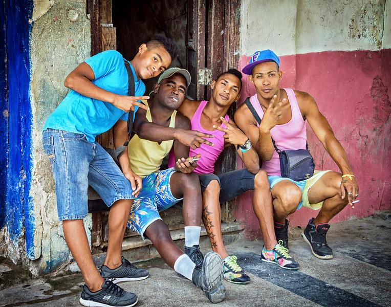 HAVANA, CUBA - March 19, 2016.  Cuban boys hanging out on the streets of Old Havana, Cuba