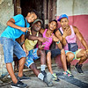 HAVANA, CUBA - March 19, 2016.  Cuban boys hanging out on the streets of Old Havana, Cuba