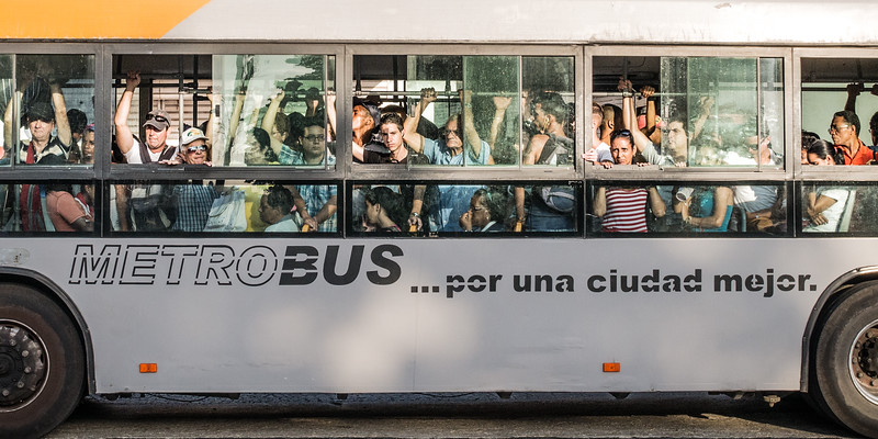 Bus to work, El Prado, Havana