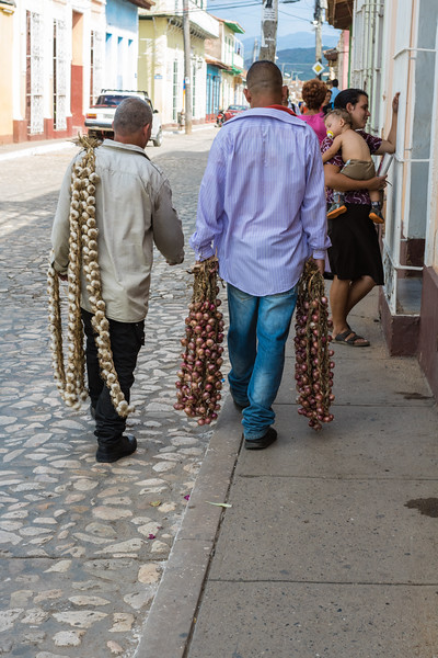 Vendors with braids of garlic and onion, Trinidad