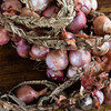 Braided red onions on a wooden table