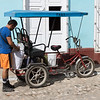 Man getting his bicycle taxi ready, Trinidad