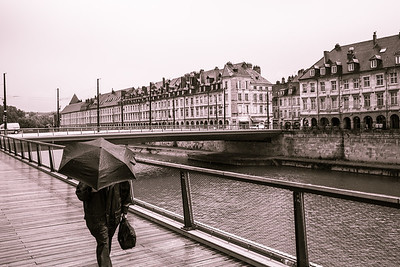 Men walking under the rain - Besancon (france)