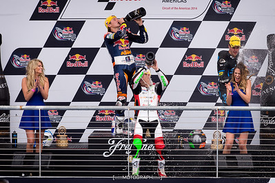 Moto3 race winners Jack Miller, Romano Fenati, and Efren Vasquez celebrate with the Red Bull paddock girls