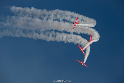 The Aeroshell Aerobatic Team catches the light during their inspired performance