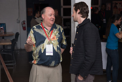 Lee Papert, President & CEO of the Dallas Film Society, talks with a guest at the SAG Indie Party during the 2017 Dallas International Film Festival at the Bowlounge in Dallas, Texas on April 5,2017. (Photo by Sam Hodde for the Dallas International Film Festival)
