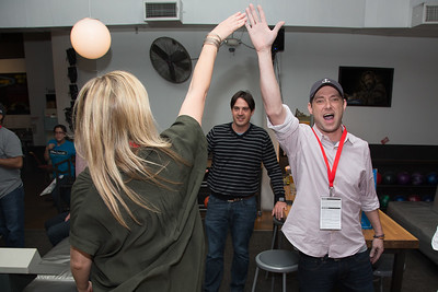 Attendees high five during a game of bowling at the SAG Indie Party during the 2017 Dallas International Film Festival at the Bowlounge in Dallas, Texas on April 5,2017. (Photo by Sam Hodde for the Dallas International Film Festival)