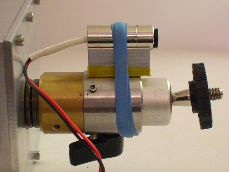 Diode laser and V-block, used to calibrate the drive axis to the Red Dot Finder.