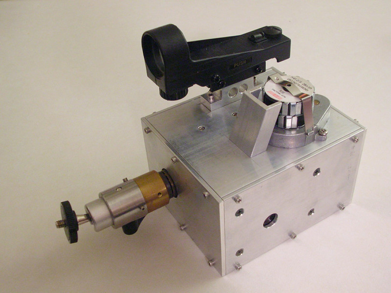 Opposite side view of the sidereal camera drive, showing the tripod socket and red-dot finder and geared stepper motor