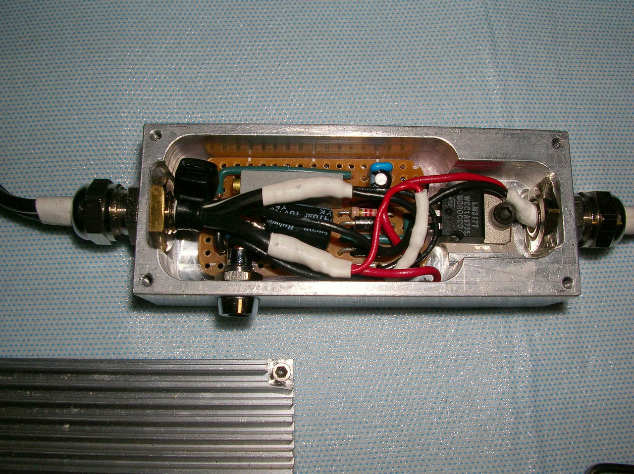 Powered by an LM317 Adjustable Linear Regulator for very clean DC power.  the Circuit board was placed inside a custom machined aluminum case.