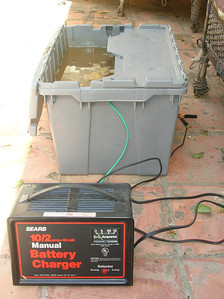 Electrolysis bath and power source.  - Only running about 1A