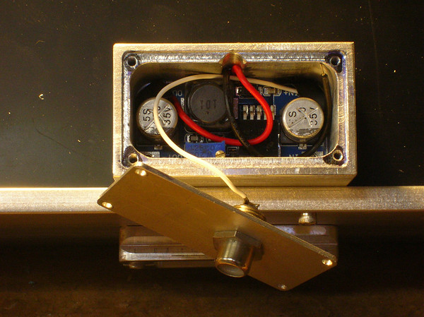 Internal view of the DC-DC converter, with the adjustable potentiometer for varying the voltage and thus the panel brightness.  Just need to solder that last ground wire.