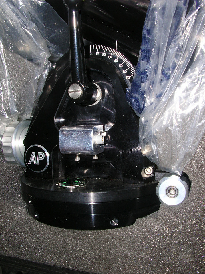 A shot of the laser, mounted on an Astro-Physics Mach1GTO.  The socket head cap screws seat against a steel shim, which is padded (on the telescope side).  The opposite face contains 2-sided tape to prevent marring and also to help secure the laser in position