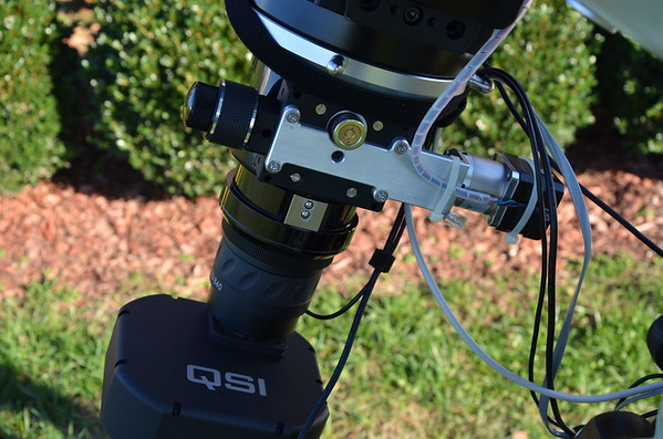 Custom focus motor mount on the Skywatcher Quantum 120 CF telescope.  Photo by Craig & Tammy Temple