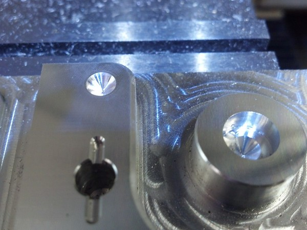 Re-spot drilled hole