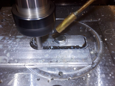 Machining the top spring holders