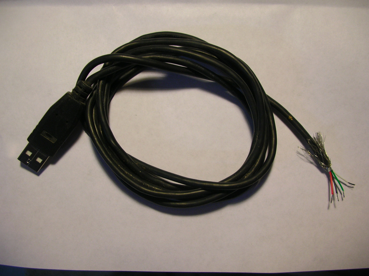 An old camera USB cable was used for connection to the card reader.  The wires were stripped as shown.