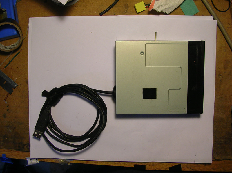 "Cover installed on the card reader (salvaged from an old 3.5"" floppy drive)"