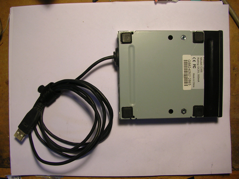 Bottom of the card reader, with included feet for desktop traction.
