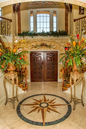 Hand-carved solid Honduran Mahogany wood double doors greet you at the front entrance of the Grande Ritz Palm.