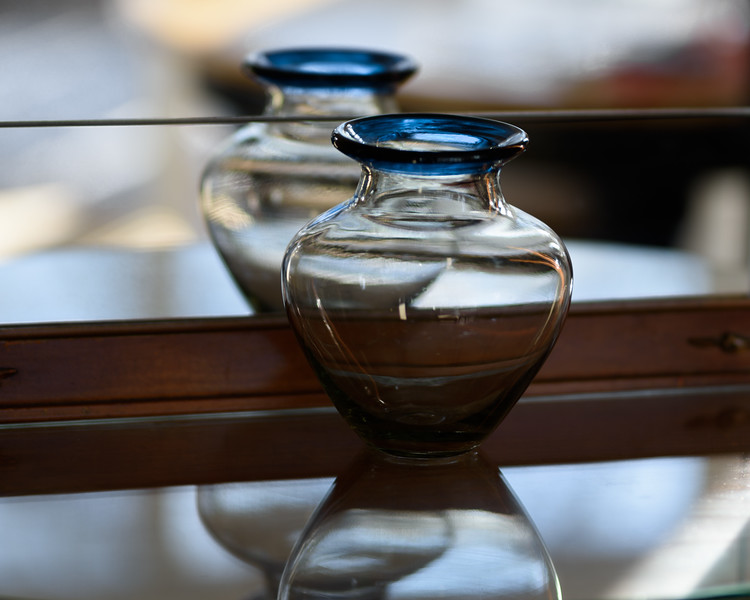 Blue-Rimmed Vase with Reflection