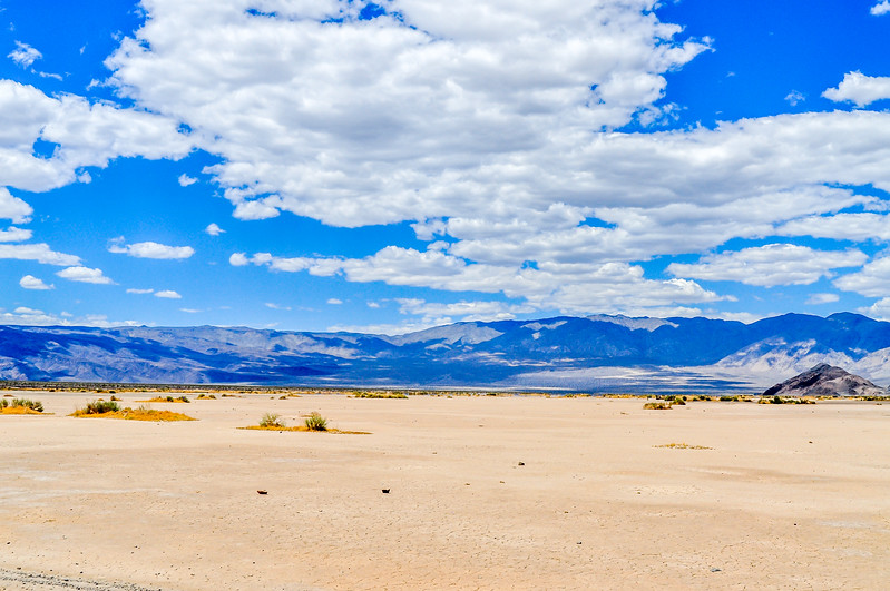 White Clouds & Blue Sky Over the Desert