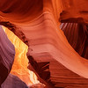 "Antelope Canyon is among a handful of spots that are likened to the ""holy grail"" of landscape photography. I've been fortunate enough to have been invited on private photo tours through several canyons like this in Arizona and southern Utah and am always blown away by the beauty everywhere I look. The colors dazzle in red, yellow, orange and sometimes hints of purple while the asymmetrical canyon walls are a maze of geometrical anarchy.  All of this combines into the makings of epic photographs."