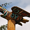 Carved raven on the top of a totem pole.<br /> Saxman Totem Park, Ketchikan, AK.<br /> July 15, 2010.