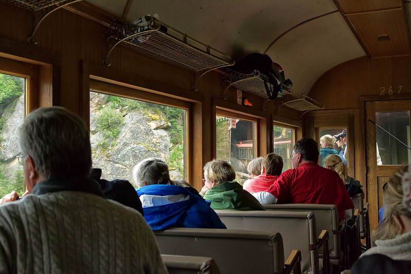 Tauck Tourists fill a passenger coach in the White Pass & Yukon Route train.<br /> Skagway, AK.<br /> July 14, 2010.